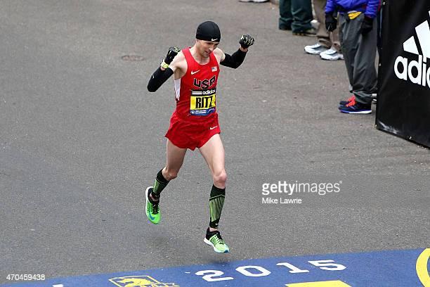 Dathan Ritzenhein of the United States crosses the finish line during the 119th Boston Marathon on April 20 2015 in Boston Massachusetts