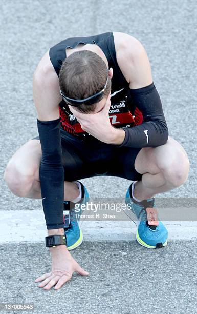 Dathan Ritzenhein with a time of 20955 drops to the ground after finishing fourth in the US Marathon Olympic Trials January 14 2012 in Houston Texas