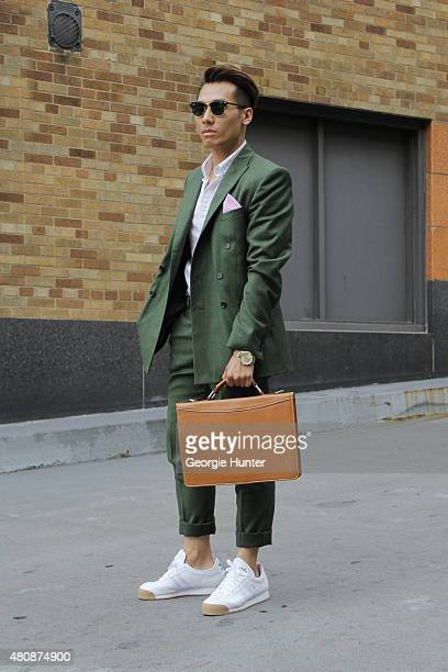 Dathias Hoang seen at Skylight Clarkson Sq outside the Richard Chai show wearing Darkoh suit HM shirt a vintage bag Adidas sneakers RayBan sunglasses...