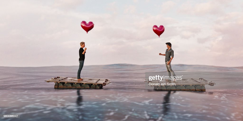 Dating concept: same sex couple, two men, on rafts meet in ocean : Stock-Foto