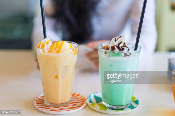 dating in the cafe - mint green stock pictures, royalty-free photos & images