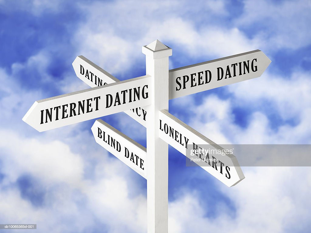 Dating sign post against cloudy sky : Foto stock