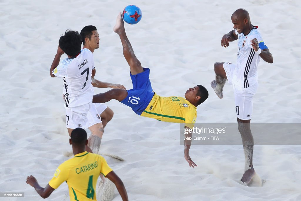 Datinha of Brazil attempts a bicycle kick between Teruki Tabata, Takaaki Oba and Ozu Moreira of Japan during the FIFA Beach Soccer World Cup Bahamas 2017 group D match between Brazil and Japan at National Beach Soccer Arena at Malcolm Park on May 2, 2017 in Nassau, Bahamas.