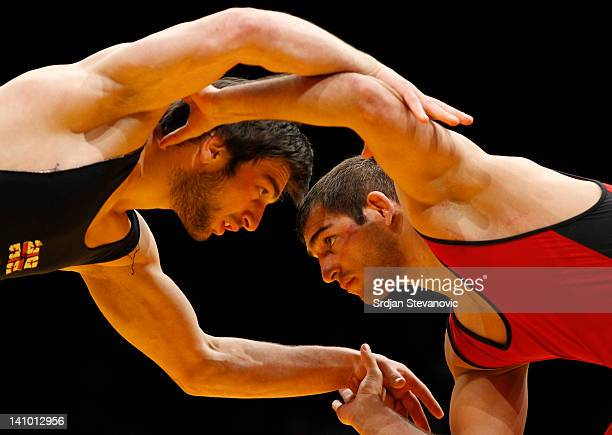Dato Marsagishvili of Georgia competes for the bronze medal with Mihail Ganev of Bulgaria of Men's Freestyle 84kg during the European wrestling...