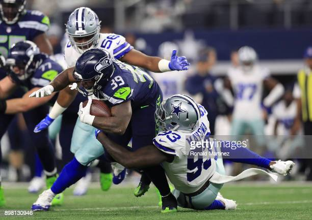Datone Jones of the Dallas Cowboys and Benson Mayowa of the Dallas Cowboys stop the run by Mike Davis of the Seattle Seahawks in the second quarter...