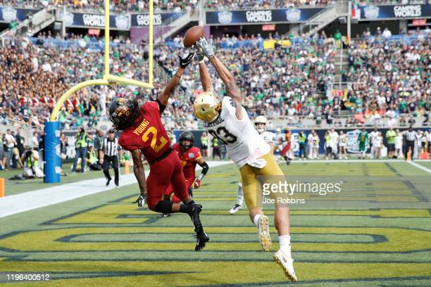 Datrone Young of the Iowa State Cyclones defends a pass in the end zone against Chase Claypool of the Notre Dame Fighting Irish in the second half of...