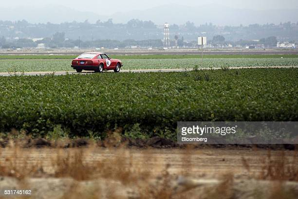 A Datsun 1983 Z280 ZX drives through farmland during the Friends of Steve McQueen Car Show Rally in Camarillo California US on Saturday May 14 2016...