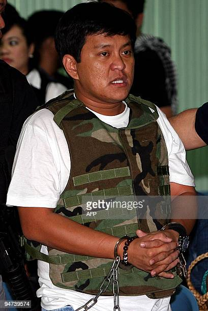 Datu Unsay Mayor Andal Ampatuan Jr accused of being behind an electionrelated massacre is lead handcuffed and wearing a flakjacket into a court at...