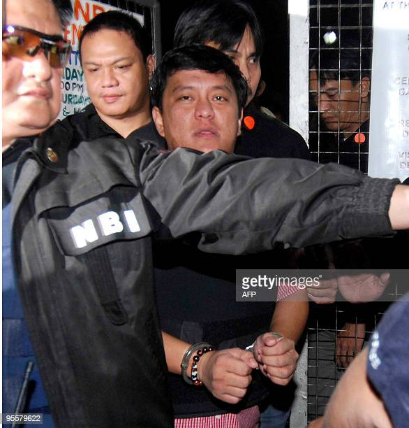 Datu Unsay Mayor Andal Ampatuan Jr in handcuffs the prime suspect in the November 23 massacre of 57 people in Maguindanao province is escorted by...