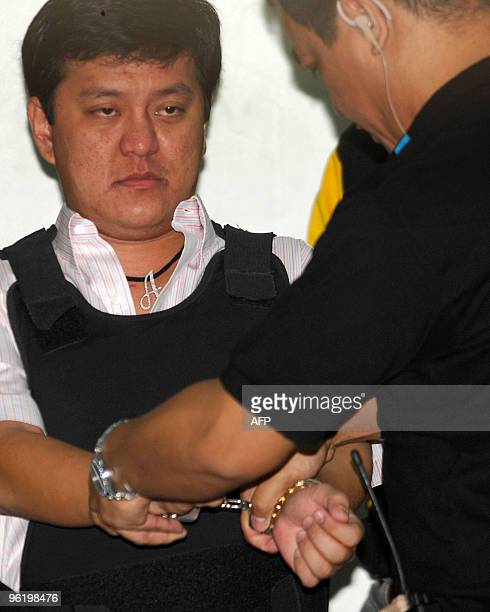 Datu Unsay Mayor Andal Ampatuan Jr prime suspect in a massacre of 57 people is placed in handcuffs as he is escorted by National Bureau of...