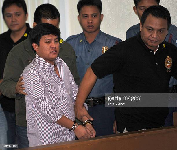 Datu Unsay Mayor Andal Ampatuan Jr the prime suspect in the massacre of 57 people in Maguindanao province is led by a National Bureau of...