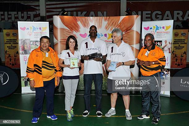Datuk Muhammad Feisol Hassan President of the Special Olympics Malaysia with Laureus Academy Member Nadia Comaneci Laureus Academy Chairman Edwin...