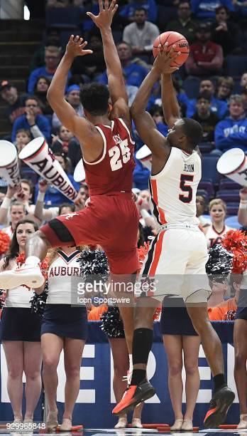 dAuburn guard Mustapha Heron shoots over Alabama forward Braxton Key uring a Southeastern Conference Basketball Tournament game between Auburn and...