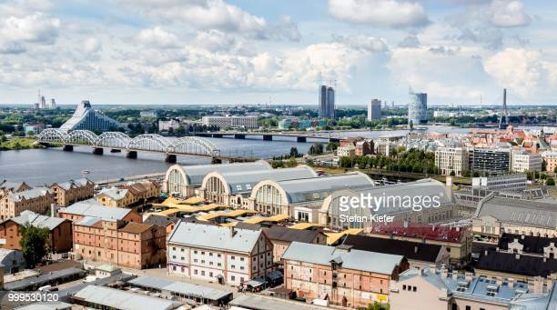 Daugava River or Western Dvina, with the Railway Bridge, Dzelzce?a tilts, Latvian National Library and market halls, Riga Central Market, Riga, Latvia