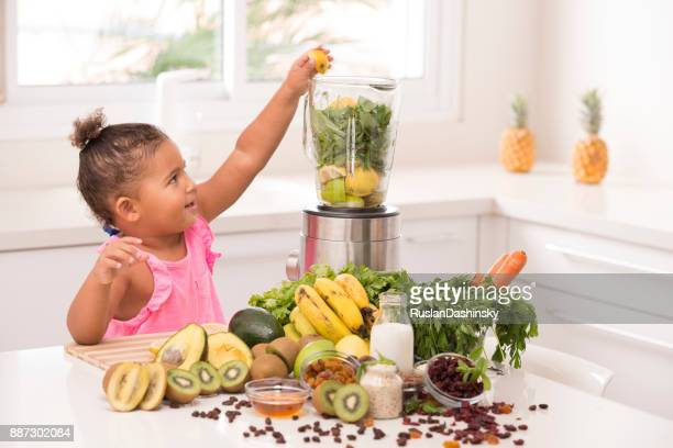 daughter 2-3 years age assistant on kitchen. making lemonade. - mint plant family stock pictures, royalty-free photos & images