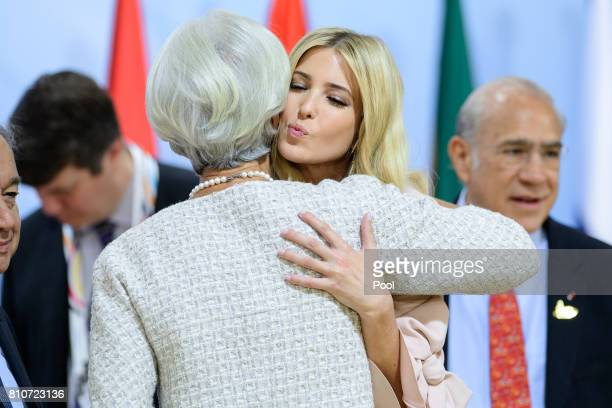 Daughter and advisor to US President Trump Ivanka Trump kisses Managing Director of the International Monetary Fund Christine Lagarde during a panel...