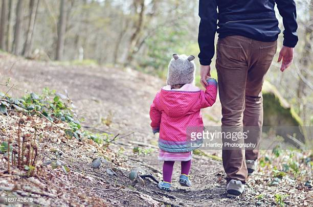 daughter and father holding hands - laura woods stock pictures, royalty-free photos & images