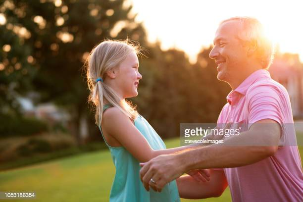 Daughter and Father Hugging