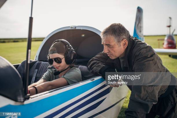 daughter and father pilot - two generation family stock pictures, royalty-free photos & images
