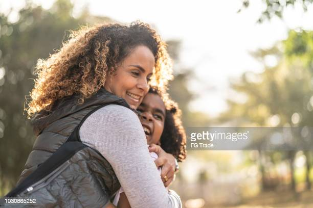 daughter and mother embracing - i love you stock pictures, royalty-free photos & images