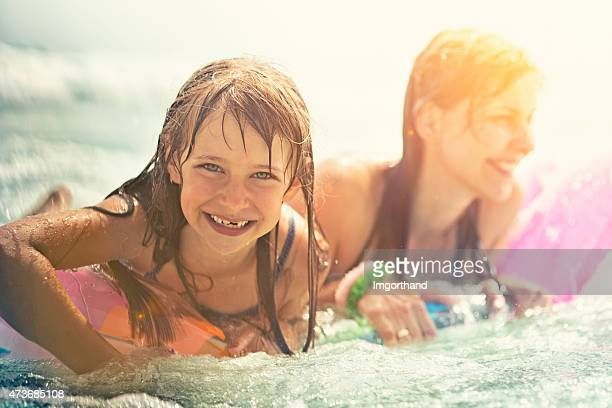 Daughter and mother having fun in sea