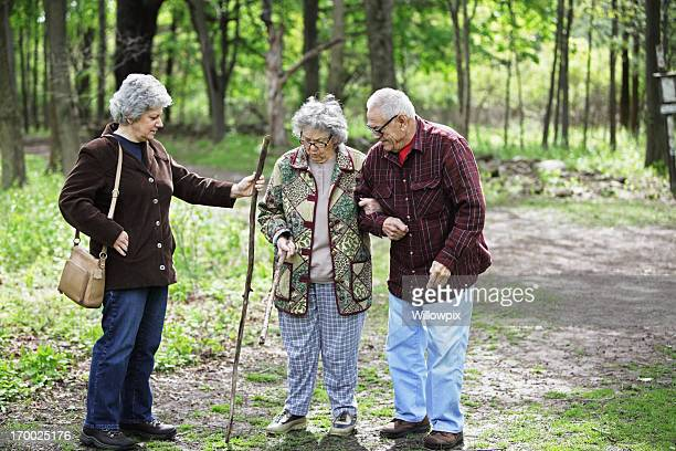 daughter and senior parents on nature trail - fat granny stock pictures, royalty-free photos & images