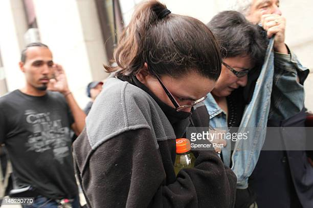 Daughter Becky Hernandez and wife Rosemary Hernandez of alleged Etan Patz murderer suspect Pedro Hernandez walk away from a courthouse with a lawyer...