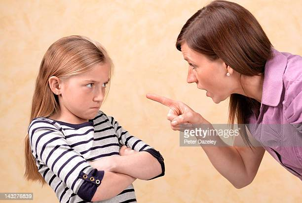 daughter being told off by her mother - mother scolding stock pictures, royalty-free photos & images