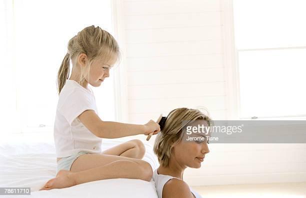 Daughter brushing mother's hair