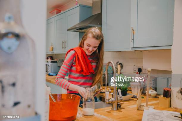 daughter cleaning the mess for her parents! - chores stock photos and pictures