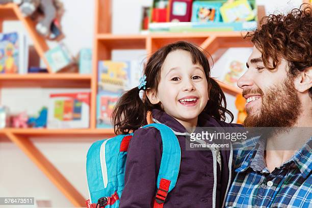 daughter embracing dad on first day of school