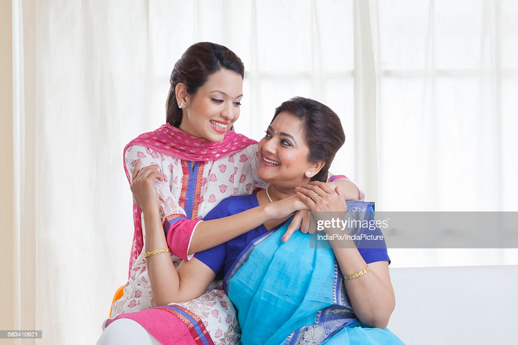 Daughter embracing her mother : Stock Photo