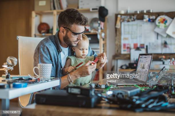 daughter enjoy to help father at home - inventor stock pictures, royalty-free photos & images