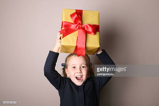 daughter gift box moving up - little girls giving head stock photos and pictures