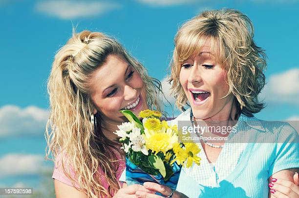 Daughter Gives Mother Flowers