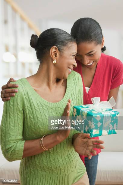 Daughter giving mother gift