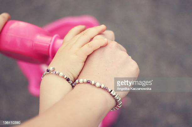Daughter holding mother hand