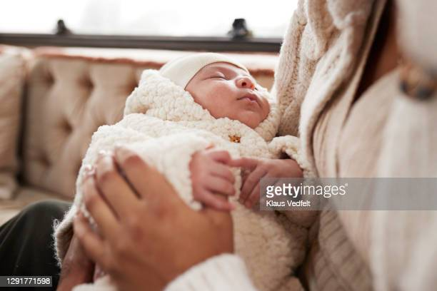 daughter holding mother's finger in motor home - mid section stock pictures, royalty-free photos & images