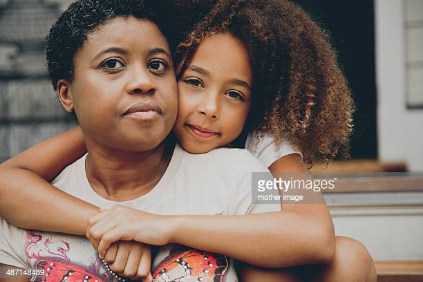 daughter hugging mom - westchester county stock pictures, royalty-free photos & images
