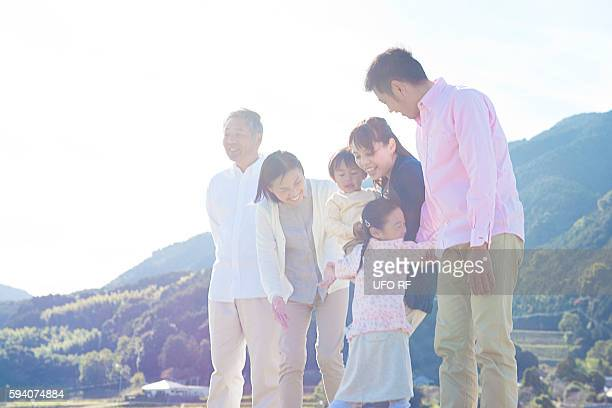 Daughter Hugging Parents and Grandparents