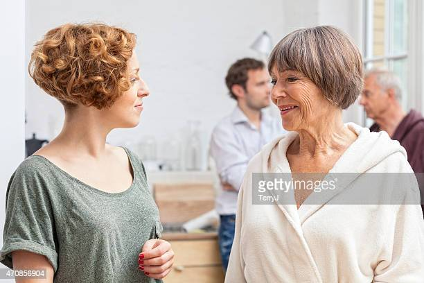 daughter in law seeks advice from mother in law - mother in law stock pictures, royalty-free photos & images