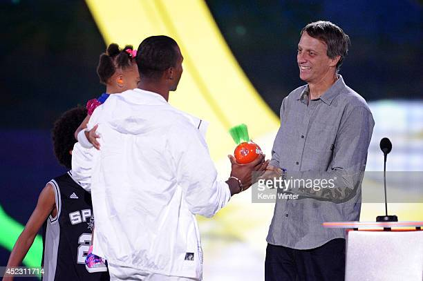 Daughter Kennedy Cruz with NFL player Victor Cruz and skater Tony Hawk speaks onstage during Nickelodeon Kids' Choice Sports Awards 2014 at UCLA's...