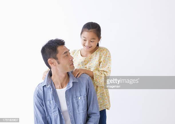 Daughter massaging father's shoulder
