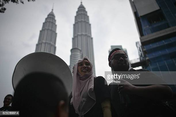Daughter of Anwar Ibrahim Nurul Izzah makes a gesture on a street outside of the iconic twintowers during rally to protest the imprisonment of...