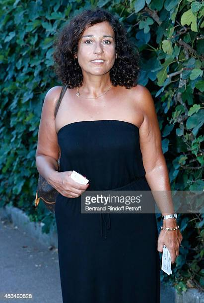 Daughter of Enrico Macias Jocya Ghrenassia attends the concert of singer Enrico Macias at the 30th Ramatuelle Festival Day 10 on August 10 2014 in...