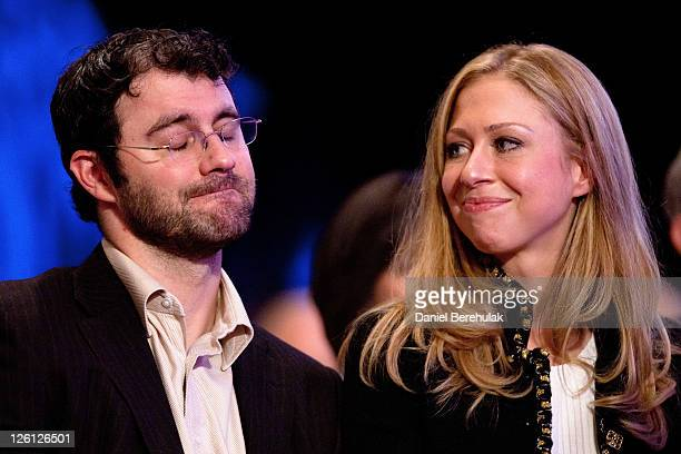 Daughter of former US President Bill Clinton Chelsea Clinton sits with her husband Marc Mezvinsky during the closing Plenary session of the seventh...
