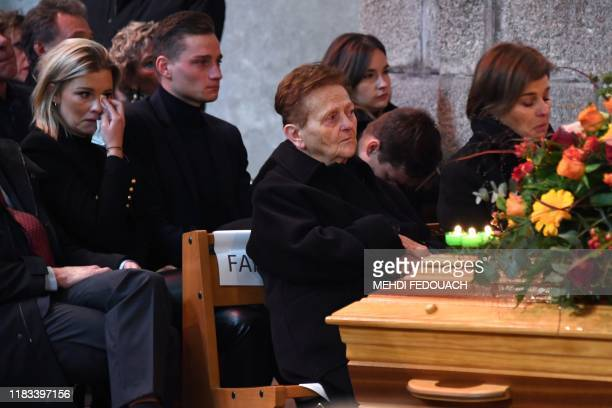 Daughter of late cyclist Raymond Poulidor Corinne Poulidor and his grandson Dutch cyclist Mathieu van der Poel attend the funerals of the French...