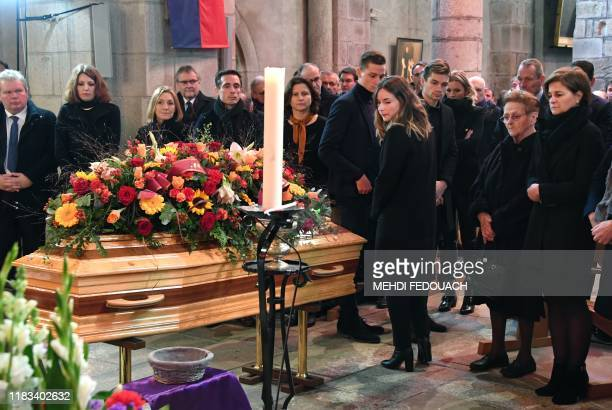 Daughter of late cyclist Raymond Poulidor Corinne Poulidor his widow Gisele Poulidor and his grandsons Dutch cyclists Mathieu van der Poel and David...