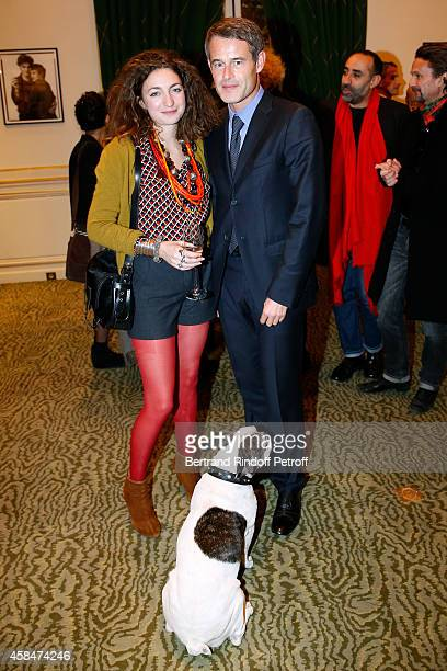 Daughter of Loulou de la Falaise Anna Klossowski de Rola Director of Fondation 'Pierre Berge Yves Saint Laurent' Philippe Mugnier and the dog of Yves...