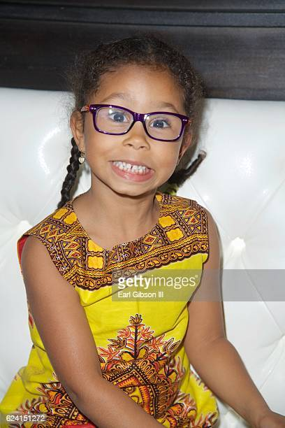 Daughter of Manuela Testolini and Eric Benet Lucia Bella Benet poses for a photo at the 'In A Perfect World Give 100 Fundraiser' at The District...